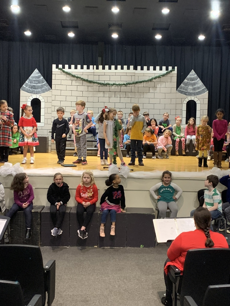 The first grade students are preparing for their Christmas play this morning.
